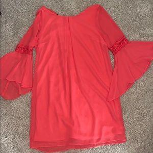 A. Byer orangish/reddish dress.